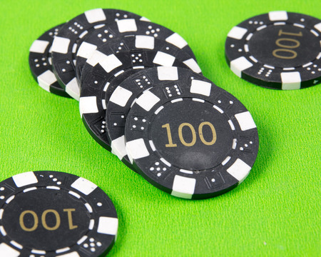 lear: casino chips on the green table Stock Photo
