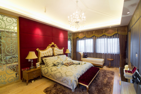 A modern european bedroom with double bed.