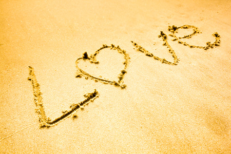 I love you written on sand on sea beach photo