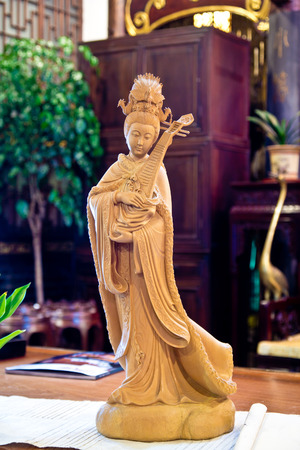 isolate Handicraft wood Thep the holy angels of benign Bring good fortune to mankind. photo