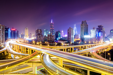 shanghai interchange overpass and elevated road in nightfall Stock Photo