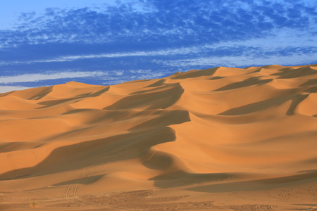 eolian: Sand dunes of desert in Xinjiang, in the blue hour Stock Photo