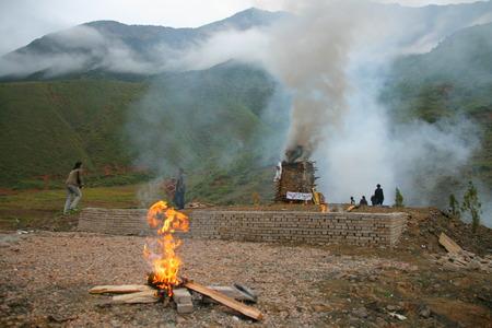 minority: LIJIANG, CHINA - SEPTEMBER 19: Cremation ceremony of Mosuo Minority People on September 19, 2013, Yongning, Linlang, Lijiang, China