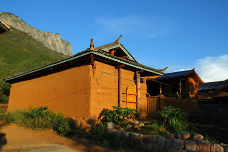 Traditional Mosuo Minority house near the Luguhu lake, Yunnan, China photo