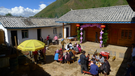 wedding feast: LIJIANG, CHINA - SEPTEMBER 19: Mosuo Minority People attend a wedding ceremony and wedding feast, September 19, 2013,Yunnan, Linlang, Lijiang, China