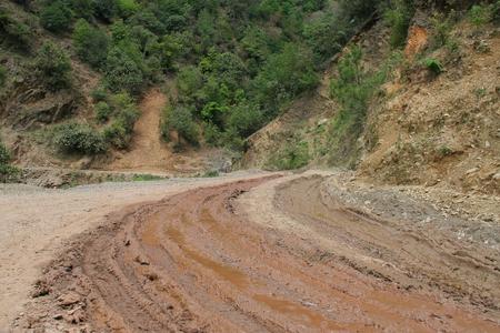 miry: Muddy mountain road in Liangshan Mountain, Sichuan, China