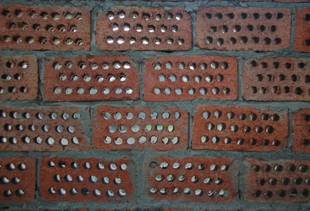 honeycombed: Red brick wall background with honeycombed holes