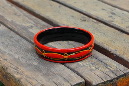 lacquerware: Bracelet on wooden board