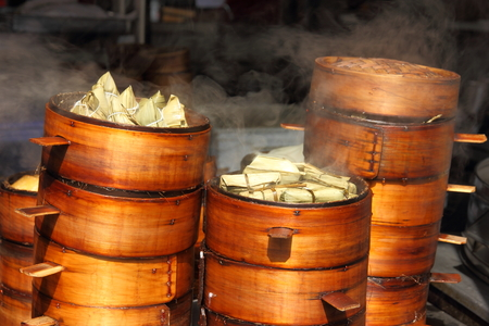Traditional Chinese rice dumplings in the bamboo baskets during cooking photo
