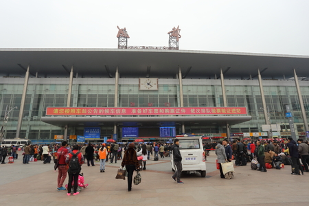 billions: CHENGDU, CHINA  JANUARY 31: Unidentified people in the square of Chengdu Railway Station. Billions of people transfer in different cities to spend Chinese new year with their family. Chengdu, Sichuan, China, January 31, 2016