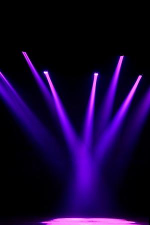 クローズ アップ写真の暗闇の中で舞台照明効果 写真素材