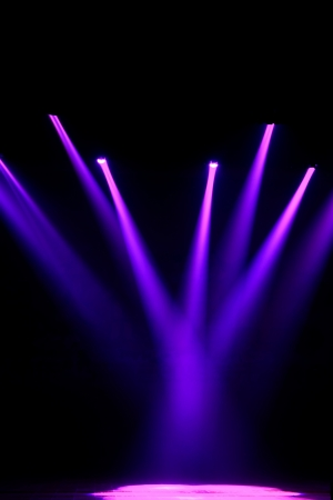 searchlights: stage lighting effect in the darkness, closeup of photo