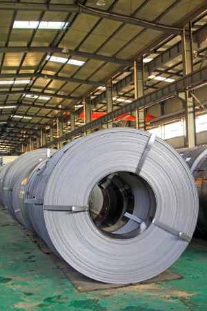 steel mill: Hot rolled strip steel products in a warehouse