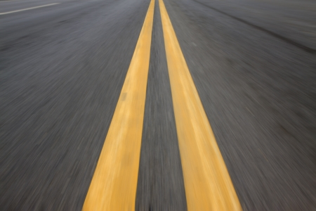 yellow double solid line on the road Stock Photo - 19007976