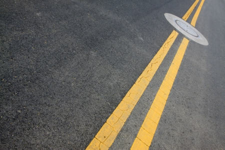 yellow double solid line on the road photo
