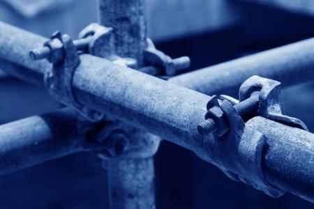 rusty metal scaffolding elements, closeup of photo
