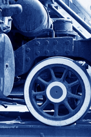 steam locomotive wheels, closeup of photo