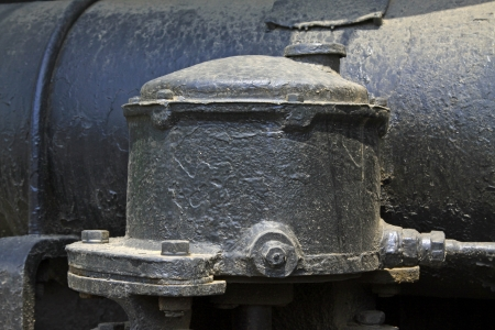 compressed air: Cast iron compressed air tank, closeup of photo