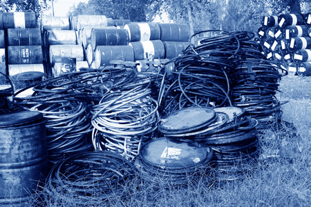 gallons: oil drum parts piled up together in a storage area
