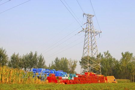gallons: oil drums and electricity tower in a storage area