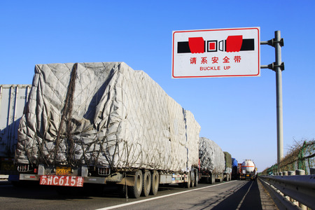 TIANJIN - DECEMBER 9: The heavy duty trucks were stopped on the highway Because of the traffic jam, on December 9, 2013, tianjin, China.