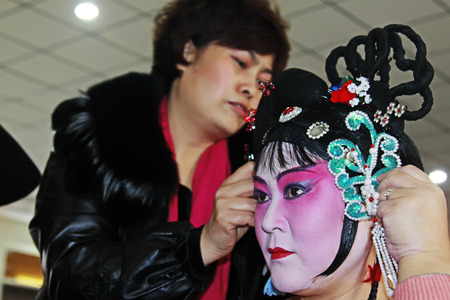 restore ancient ways: FUCHENG - DECEMBER 7: The actors was makeup in the backstage, on december 7, 2013, fucheng, hebei province, China.