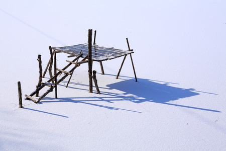 wooden support on a pond after a snow, closeup of photo Stock Photo - 27191523