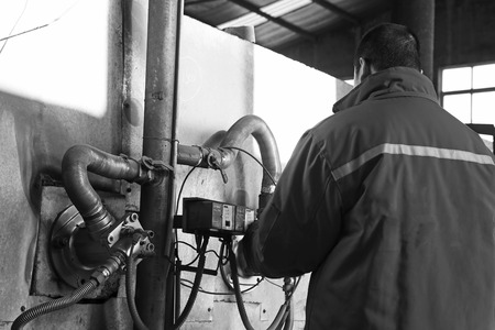 co operating: TANGSHAN - DECEMBER 20: The worker was operating gas stove, in a steel shovel manufacturing co., LTD., on December 20, 2013, tangshan city, hebei province, China.