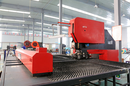 TANGSHAN - DECEMBER 22: The numerically-controlled machine tool in the production line, in a solar equipment production workshop on december 22, 2013, tangshan, china. Redakční