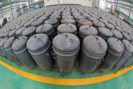 put pressure: TANGSHAN - DECEMBER 22: The pressure tank put in a warehouse workshop, in a solar equipment production workshop on december 22, 2013, tangshan, china.