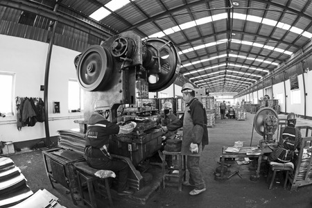 blanking: TANGSHAN - DECEMBER 20: Blanking workshop production line, in a manufacturing enterprise, on December 20, 2013, tangshan city, hebei province, China.