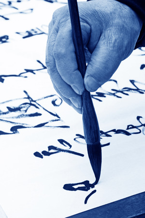 scenarios: holding a brush pen to write scenarios, closeup of photo Stock Photo
