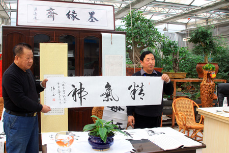 affix: TANGSHAN CITY - FEBRUARY 6: The calligrapher Chen Peiyu and Wang jiang were writing calligraphy, on february 6, 2014, Tangshan city, Hebei province, China.