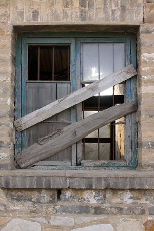 restore ancient ways: broken and closed wooden windows in a deserted place