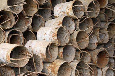 restore ancient ways: oxidation rusty metal barrels, closeup of photo
