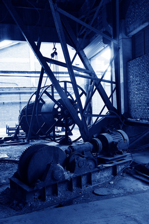 abandoned mechanical equipment in a factory, closeup of photo photo