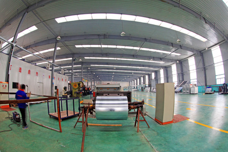 highend: TANGSHAN - DECEMBER 22: The Solar energy production equipment, in a manufacturing enterprise on december 22, 2013, tangshan, china.