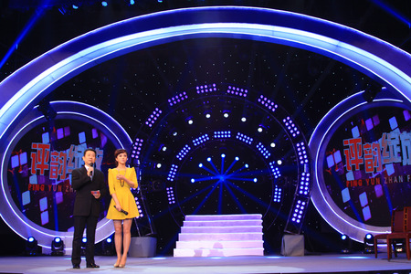 liu: LUANNAN COUNTY - JANUARY 7: The CCTVs opera channel host Zhao baole and liu chang on the stage, in the ChengZhaoCai grand theater, January 7, 2014,luannan county, hebei province, china.