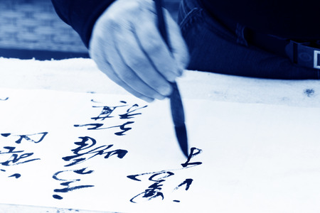 scenarios: holding a brush pen to write scenarios, closeup of photo Stock Photo