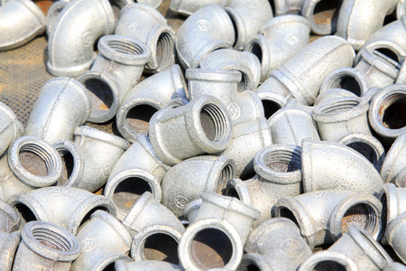 castings: Metal plumbing pipe fittings piled up together
