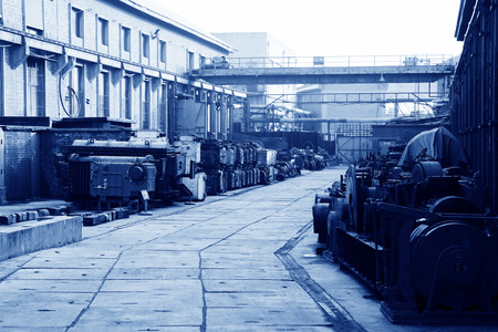 restore ancient ways: abandoned machinery in the factory area, closeup of photo