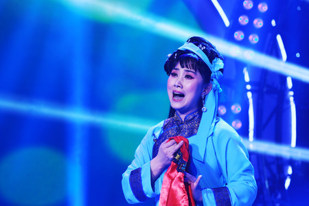 LUANNAN COUNTY - JANUARY 4: The girl dressed in tsing clothes singing PingJu on the stage, in the ChengZhaoCai grand theater, January 4, 2014,luannan county, hebei province, china.