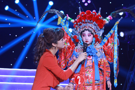 LUANNAN COUNTY - JANUARY 6: The CCTV's Opera channel presenter liu chang and actors on the stage, in the ChengZhaoCai grand theater, January 6, 2014,luannan county, hebei province, china.