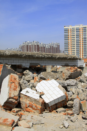 tsunamis: LUANNAN COUNTY - APRIL 6: Housing demolition materials in the demolition site and new building, April 6, 2014, Luannan county, hebei province, China.    Editorial