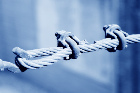 steel wire rope full of greasy dirt and connection fasteners photo