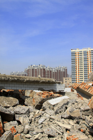 tsunamis: Housing demolition materials in the demolition site and new building