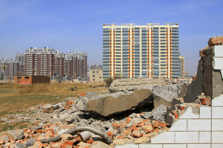 LUANNAN COUNTY - APRIL 6: Housing demolition materials in the demolition site and new building, April 6, 2014, Luannan county, hebei province, China.