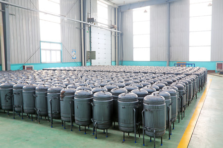 TANGSHAN - DECEMBER 22: The pressure tank put in a warehouse workshop, in a solar equipment production workshop on december 22, 2013, tangshan, china.