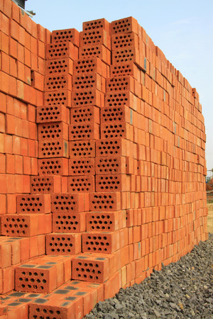 red brick repetition: piled up of  nollow brick stack in a construction site