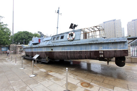 feats: BEIJING - MAY 24: No.414 Exploit Gunboat in the Toumenshan Naval Battle, in the Chinese military museum, on may 24, 2014, Beijing, China